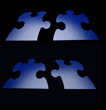 4 blue puzzle pieces